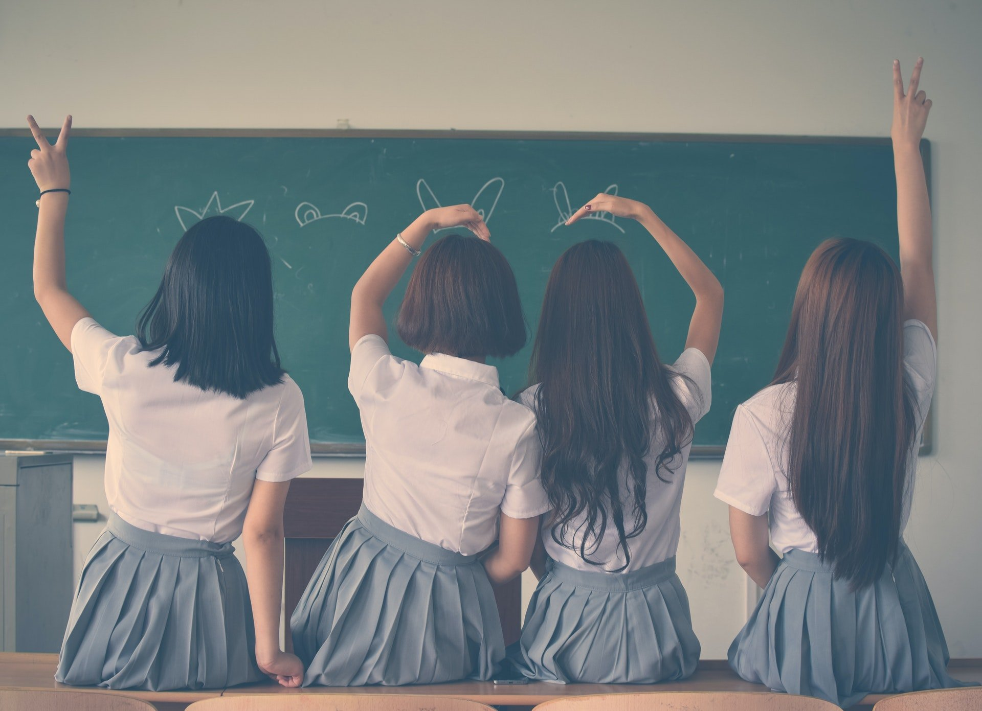 photo of girl students inside of a school classroom